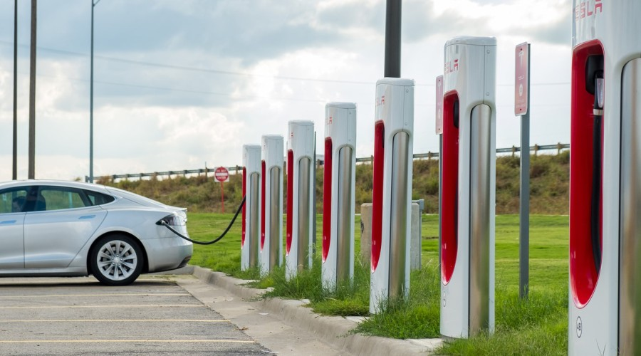 A car loads up on electricity, generating...value